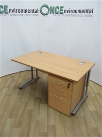 Office Interiors0F1 Beech 1400W x 800D Rectangular Desk. 18 IN STOCK.Used second hand beech 1400w x 800d rectangular desk on a silver cantilever leg frame. Complete with a 3-drawer beech under desk mobile lockable pedestal. Supplied with one key