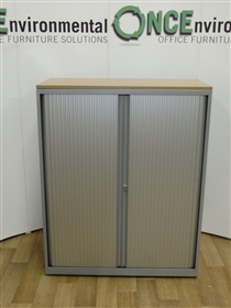 Bisley Silver Tambour Door Cupboard 1250H x 100W x 470D Available In Any Colour Laminate TopUsed second hand Bisley silver tambour door cupboard 1250h x 1000w x 470d with two adjustable shelves for three rows of A4 filing. Available in any colour laminate top. Lockable doors and supplie with one key.