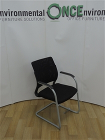 Black Mesh Back Cantilever Stackable Arm Chair Available In Any Colour Fabric SeatBlack mesh back stackable cantilever arm chair with a fabric seat. Black poly arms on a grey finish cantilever frame.