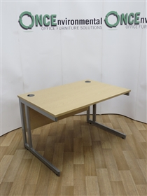 Light Oak Rectangular Desk 1200W x 800D. 12 IN STOCK.Light oak used second hand 1200w x 800d rectangular desk on a silver cantilever leg frame.