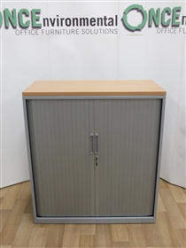 TriumphTriumph Silver Tambour Door Cupboard With A Beech Top 1110H x 1000W x 470DTriumph used second hand silver tambour door cupboard with a beech top and two adjustable shelves 1110h x 1000w x 470d.